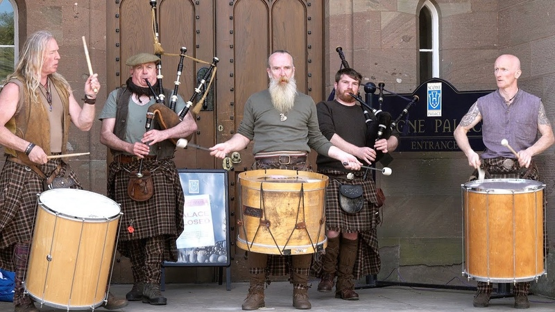 Great Scottish tribal band Clanadonia perfom Hamsterheid in front of Scone Palace Scotland 2018