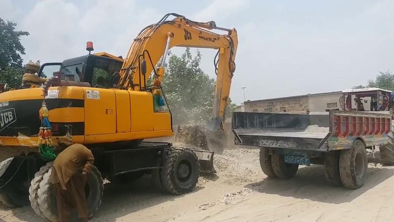 Cat 365C Excavator Loading Trolley In Village New Developments Constructions In Village