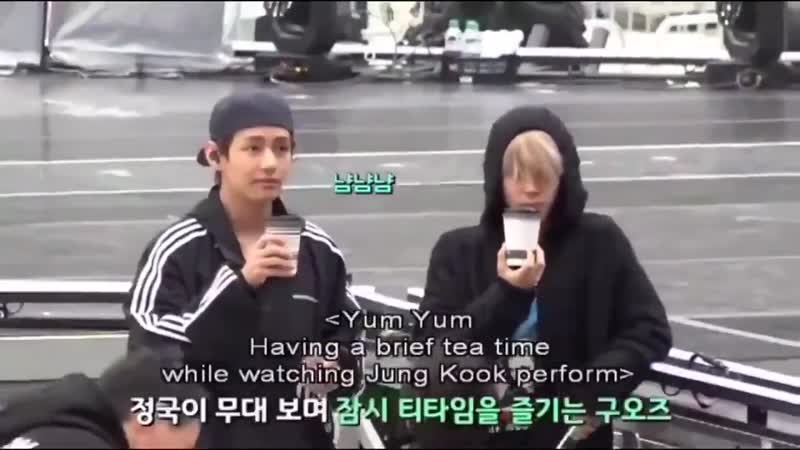 Jimin and taehyung drinking their tea in sync while watching jungkooks rehearsals