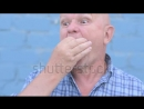 Stock-footage-crazy-russian-elderly-man-with-a-shaved-head-is-holding-an-insect-gryllotalpidae-and-eats-pest