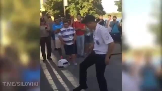 Russian policeman hit foreigners with possession of a ball Just A Dream