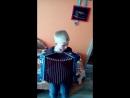 Сёма учится играть частушки на гармошке