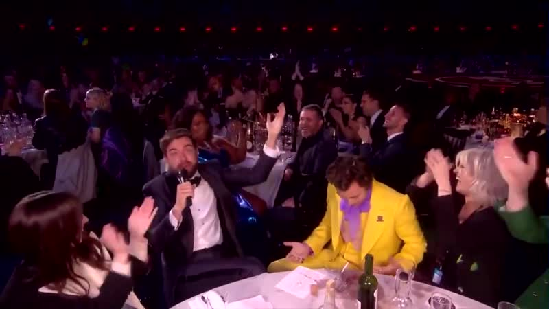 Jack spilling a drink on Harry's suit at the BRITs