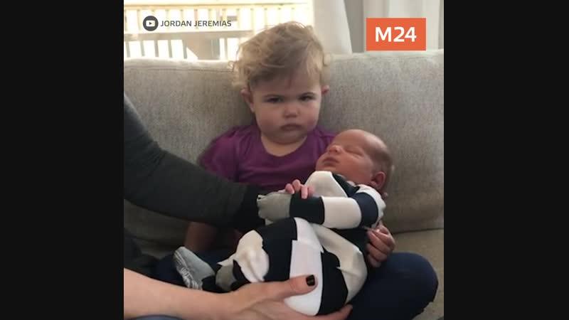 Маленькая девочка видит своего брата в первый раз